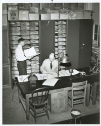 Photo: E. Moul and M.A. Johnson in the herbarium.